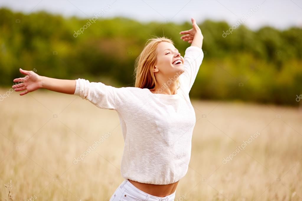 Happy woman with outstretched arms