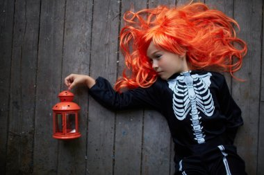 Girl in red wig and Halloween costume