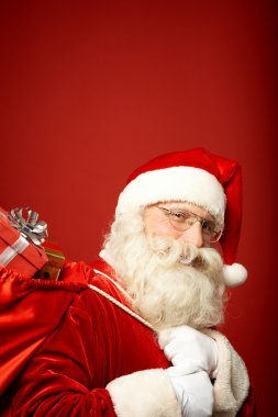 Santa Claus carrying sack with gifts