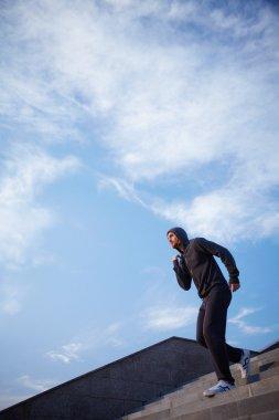Sportsman running downstairs