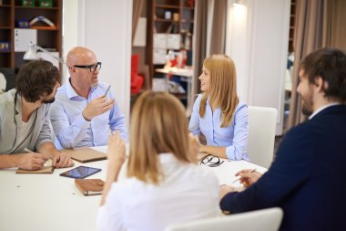 Business people communicating at meeting