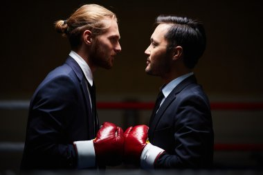 Businessmen in boxing gloves