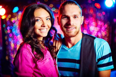 Smiling couple at party