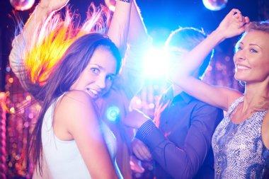 People dancing in night club