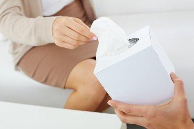 Patient hand taking paper tissue