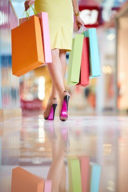 After elegant woman legs and shopping bag