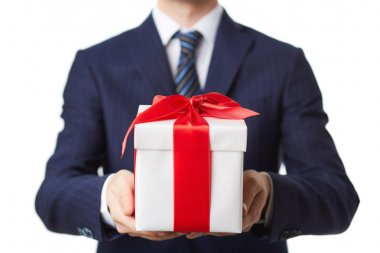 Businessman in suit holding giftbox