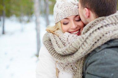 Man kissing woman in winter