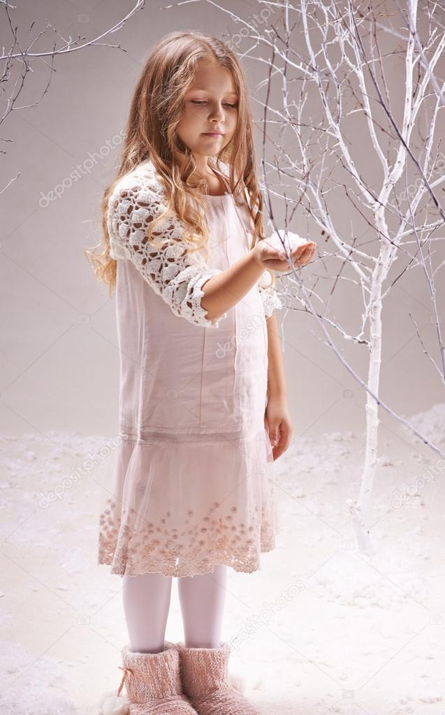 Girl holding heap of snowflakes