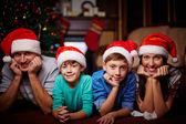 Parents and kids in Santa caps