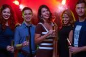 Friends enjoying party in night club