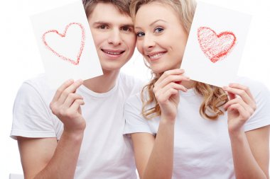 Portrait of couple with  hearts