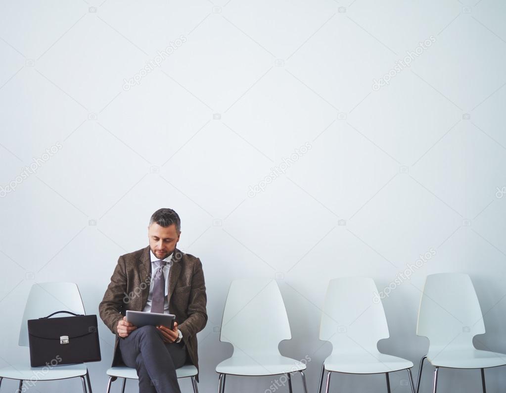 man in formalwear networking