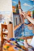 artist painting street of Venice