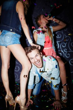 man having fun with girls in club