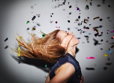 woman dancing in nightclub with  confetti