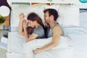 Fotografie Young couple sleeping in bed