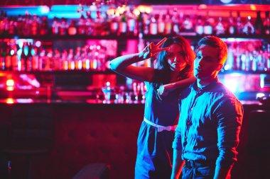 couple in bar of night club