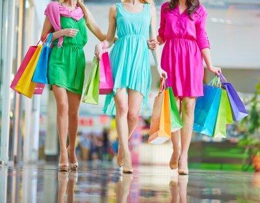 women in bright dresses   in mall