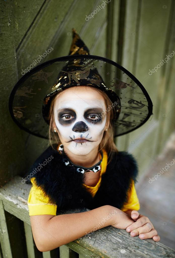 Halloween Girl With Painted Face Stock Photo Pressmaster 79701632
