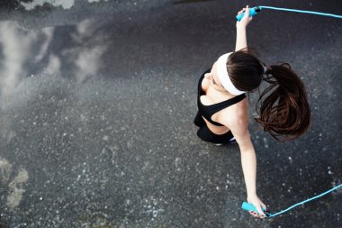 girl jumping with skipping-rope