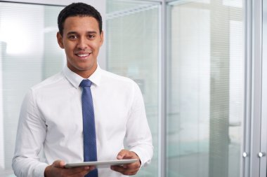 Happy businessman with touchpad