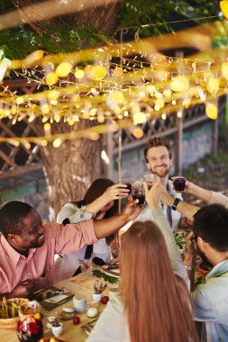 friends toasting at Thanksgiving party
