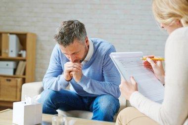 man visiting his psychologist