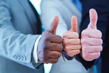 Three business people showing thumbs up gesture, close up stock vector