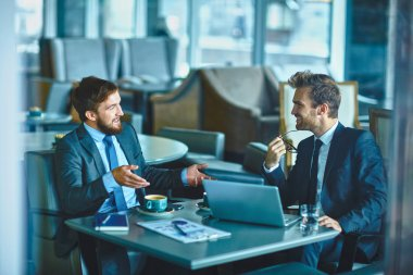 confident businessmen sharing their ideas