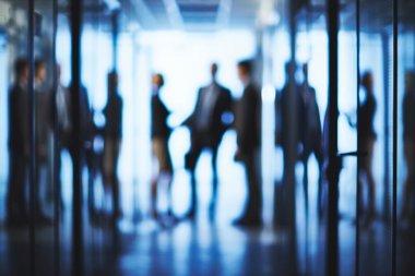 business partners interacting in corridor