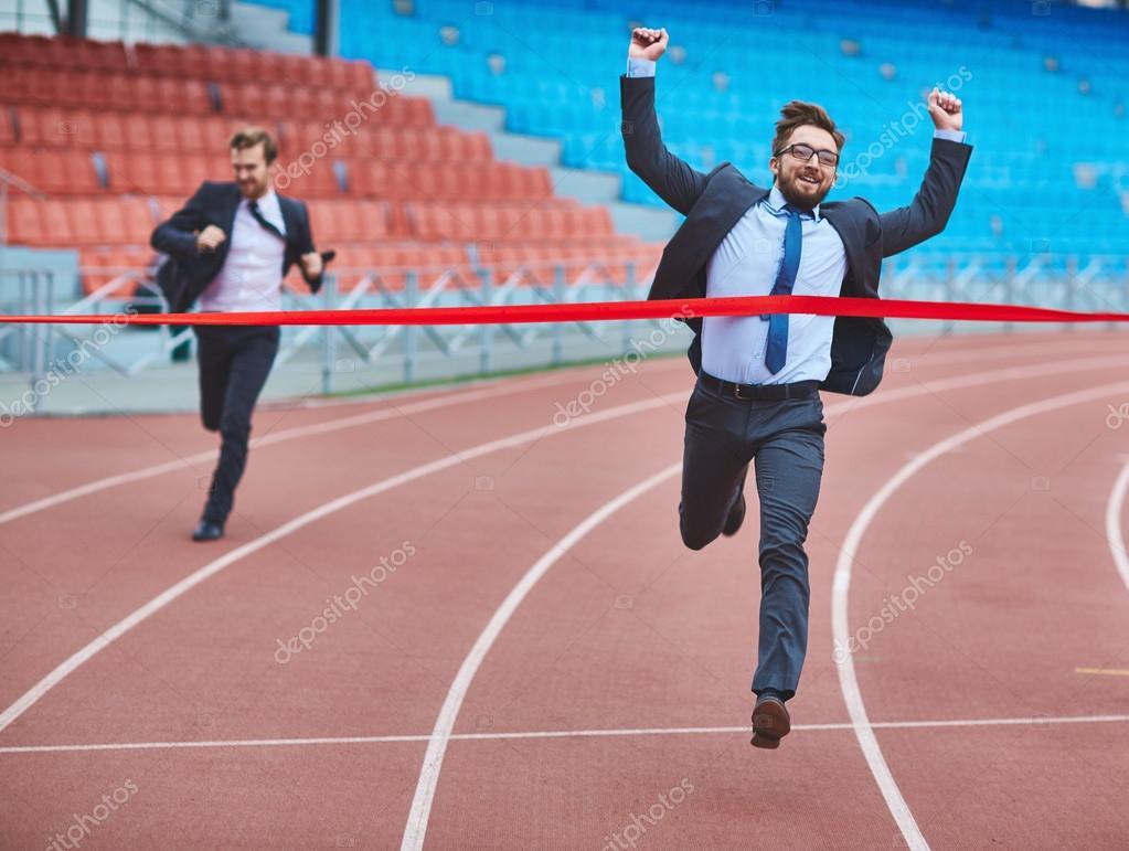businessman reaching finish at stadium