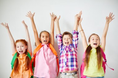 Ecstatic kids with backpacks