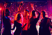 young people dancing in the night club