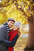 Amorous couple in autumn park