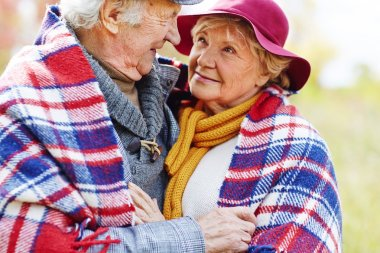 Retired seniors in warm clothes