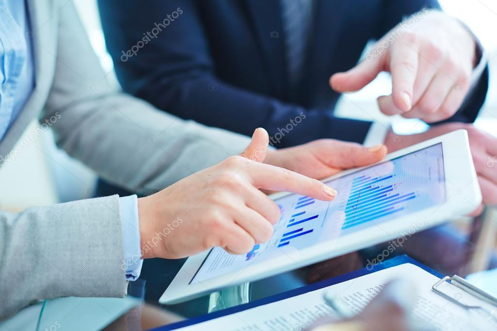 People pointing at graphs in touchpad at meeting stock vector