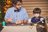 Photo man and  son making Christmas prints