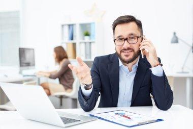 Office worker speaking on cellphone
