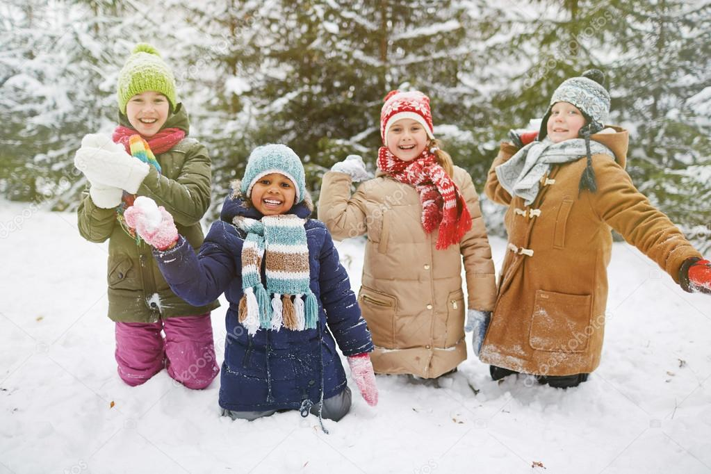 Snowball players in winter forest