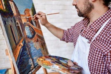 Modern artist painting landscape