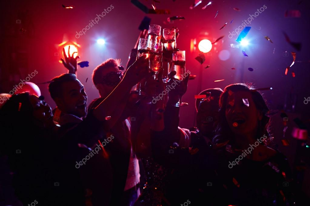 friendly people toasting in night club