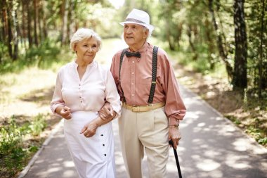 Elderly couple in smart casual-wear