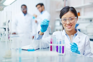 Young scientist making experiment