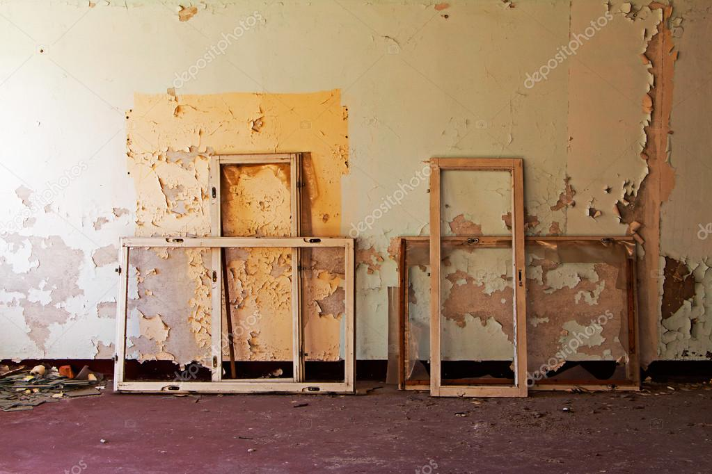 Window frames in old and abandoned room
