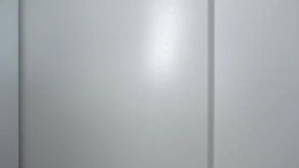 The elevator doors open. The freight elevator opens the beige doors. Floor number buttons close-up, 4k video.