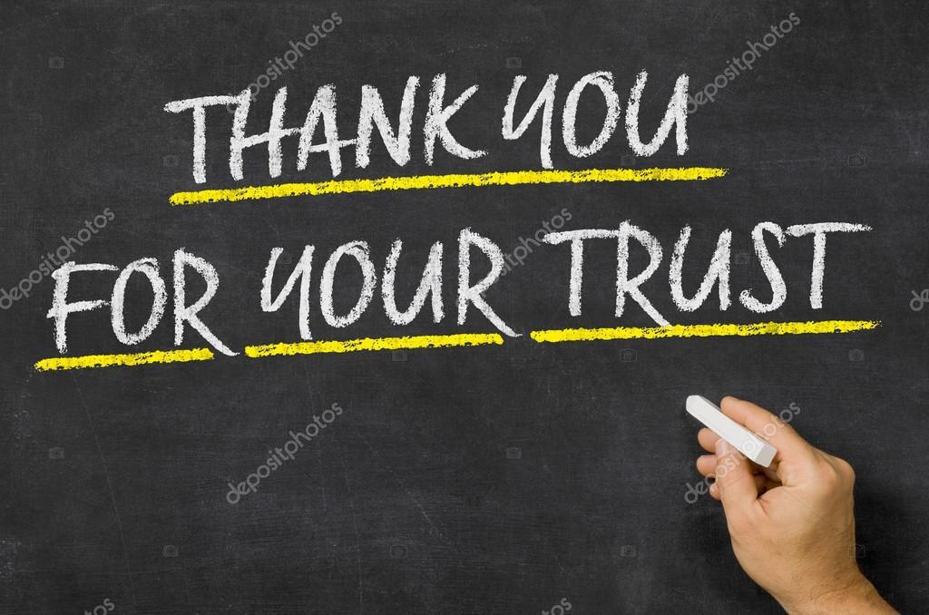 Je vous remercie pour votre confiance, écrit sur un tableau noir