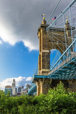 Cincinnati, OH--Aug 29, 2018; view of the south tower of John A. Roebling steel suspension bridge with downtown skyline in background