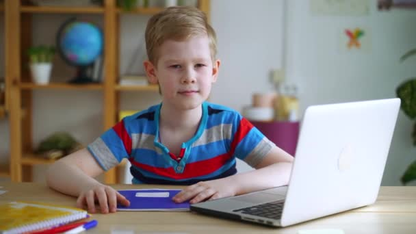 Boy student smile at camera when doing school programming homework with laptop at home Spbas. Little