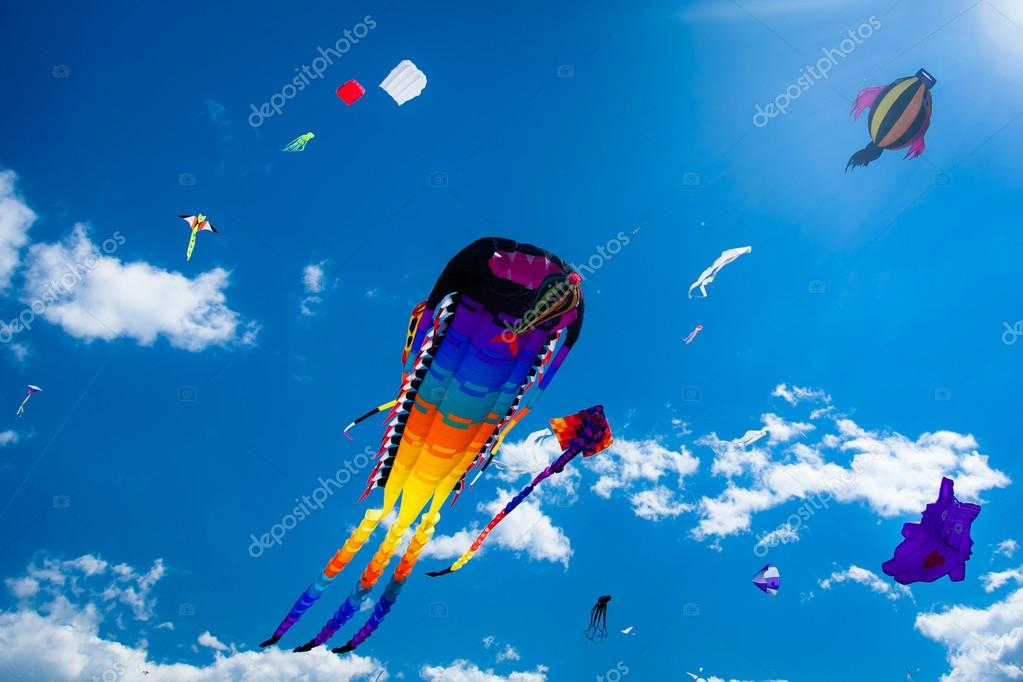 Various kites flying on the sky